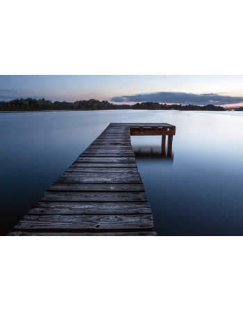 Obraz na płótnie Pomost na jeziorze o zachodzie słońca